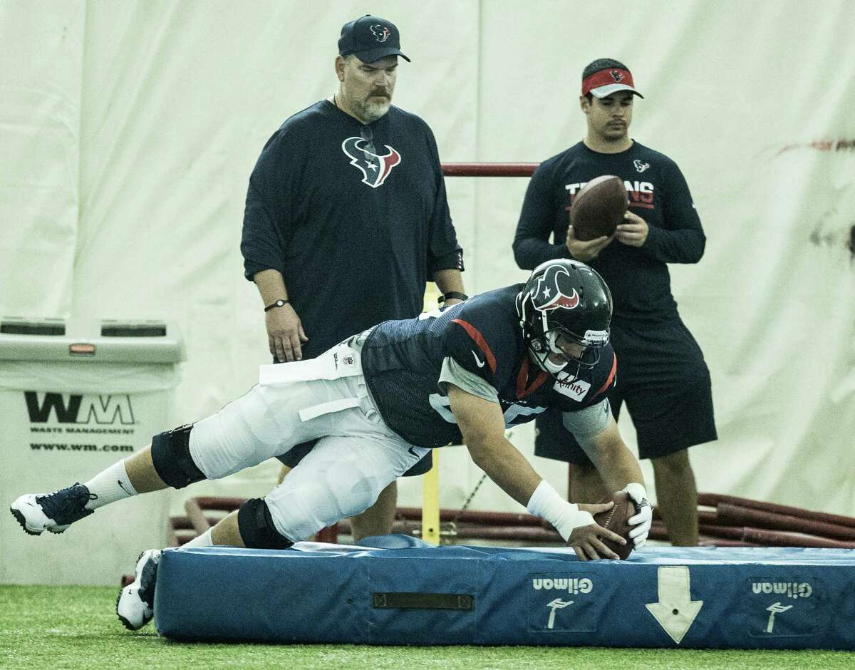 Houston Texans center Greg Mancz (65) dives on a loose ball during a fumble drill during Texans training camp at Houston Methodist Training Center on Tuesday, Aug. 16, 2016, in Houston.