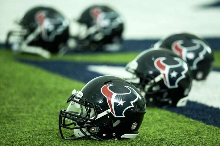 Houston Texans helmets are shown on the turf during Texans training camp at Houston Methodist Training Center on Tuesday, Aug. 16, 2016, in Houston.