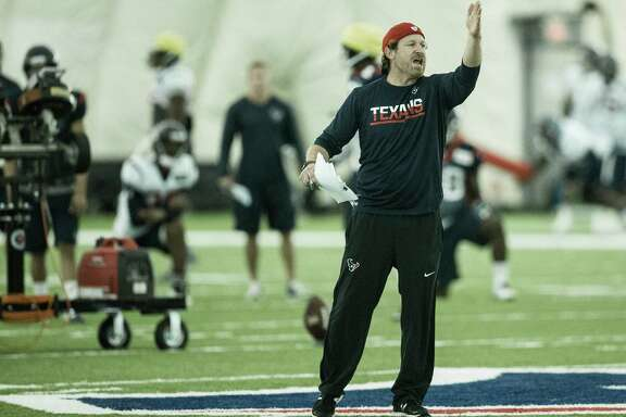 Houston Texans special teams coordinator Larry Izzo calls a play during Texans training camp at Houston Methodist Training Center on Tuesday, Aug. 16, 2016, in Houston.