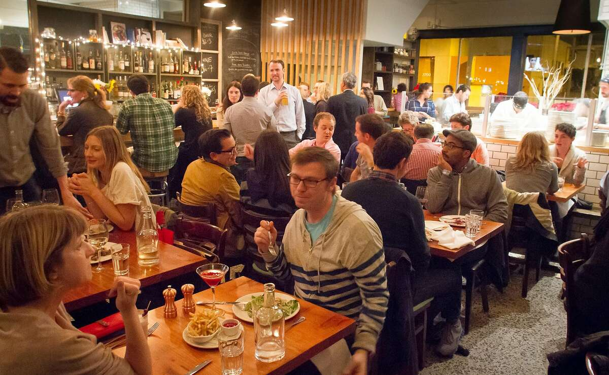 Diners enjoy dinner at Corner Store restaurant in San Francisco, Calif., on Tuesday, December 4th, 2012.