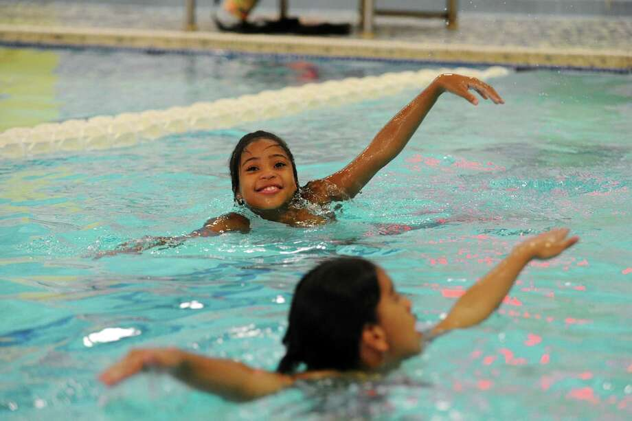 Stamford kids overcome fear of water in swim safety class - Stamford swimming pool opening times ...