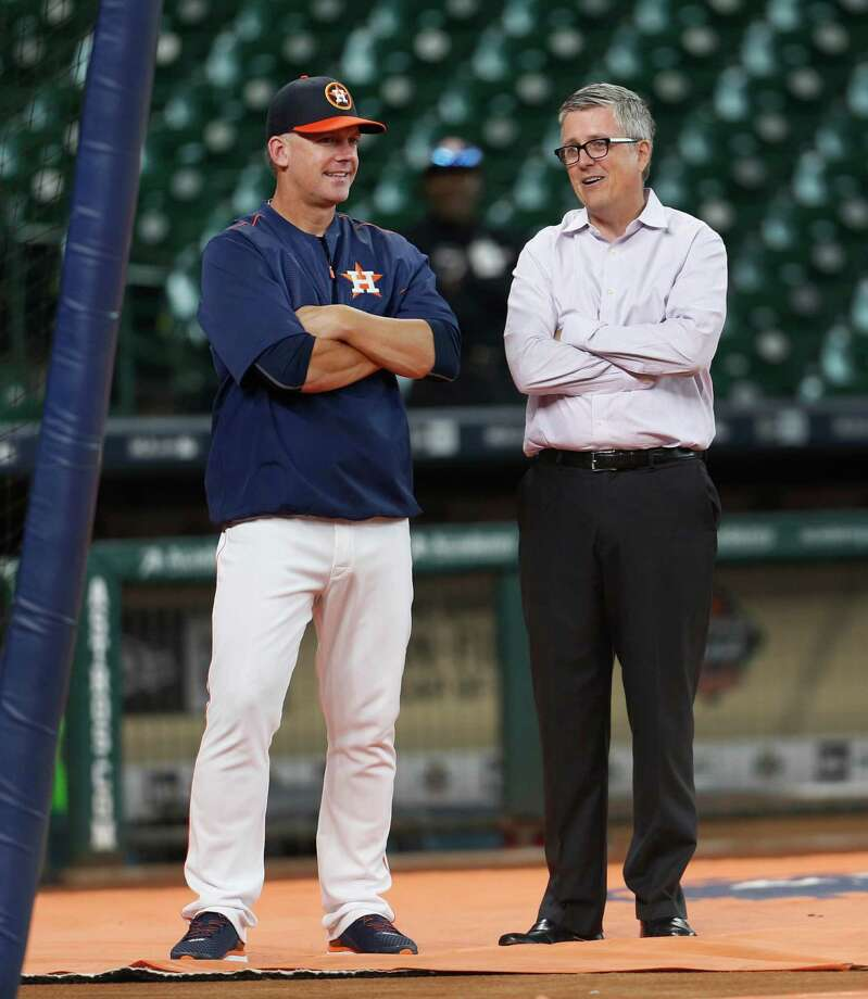 Houston Astros manager A.J. Hinch chats with GM Jeff Luhnow during batting practice before the start of an MLB game at Minute Maid Park,Tuesday, Aug. 16, 2016, in Houston. Photo: Karen Warren, Houston Chronicle / © 2016 Houston Chronicle