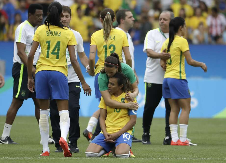 Brazil's Marta is comforted after the penalty kicks during a semi-final match of the women's Olympic football tournament between Brazil and Sweden at the Maracana stadium in Rio de Janeiro Tuesday Aug. 16, 2016. Sweden qualified for the final after beating Brazil on a penalty shoot-out.(AP Photo/Natacha Pisarenko) Photo: Natacha Pisarenko, Associated Press