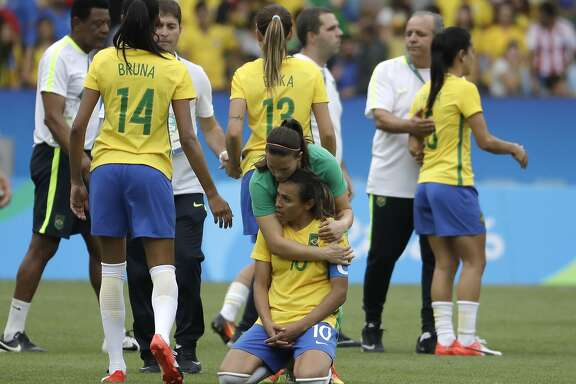 Brazil's Marta is comforted after the penalty kicks during a semi-final match of the women's Olympic football tournament between Brazil and Sweden at the Maracana stadium in Rio de Janeiro Tuesday Aug. 16, 2016. Sweden qualified for the final after beating Brazil on a penalty shoot-out.(AP Photo/Natacha Pisarenko)