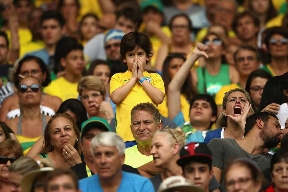 RIO DE JANEIRO, BRAZIL - AUGUST 16:  Brazil fans look on during the Women's Football Semi Final between Brazil and Sweden on Day 11 of the Rio 2016 Olympic Games at Maracana Stadium on August 16, 2016 in Rio de Janeiro, Brazil.  (Photo by Mark Kolbe/Getty Images) Photo: Mark Kolbe, Getty Images