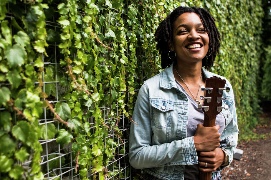 "Nia Johnson stands in a green space within the Seattle Center on Aug. 9, 2016. After dropping out of college, the 21-year-old moved back to Seattle - the city where she went to high school - to pursue her music career. ""Seattle is the best place for me when it comes to my music. I find inspiration in the way the city moves. I love the air here,"" Johnson said. (Lacey Young, seattlepi.com) Photo: LACEY YOUNG/SEATTLEPI.COM, Lacey Young / Seattlepi.com"