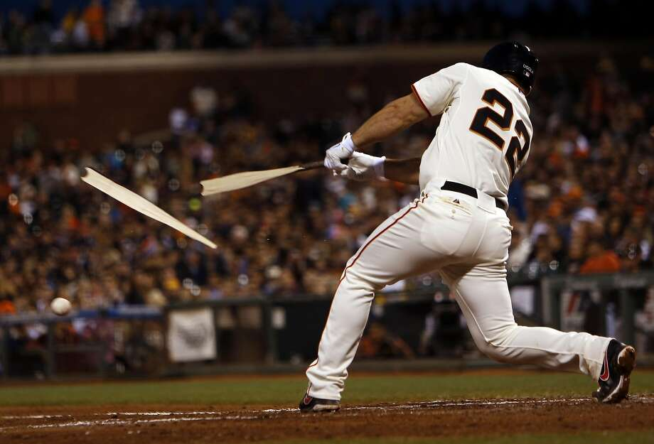 Shattered bats, like that of the Giants' Dan Uggla during a 2014 game, have become a dangerous trend. Maple bats are the biggest offenders. Photo: Scott Strazzante, The Chronicle