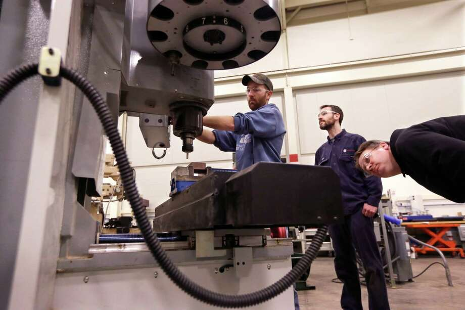 Between now and 2017, Houston will have 74,000 openings annually for middle-skill jobs, according to a study by the Greater Houston Partnership. (AP File Photo/Carlos Osorio) Photo: Carlos Osorio, STF / AP