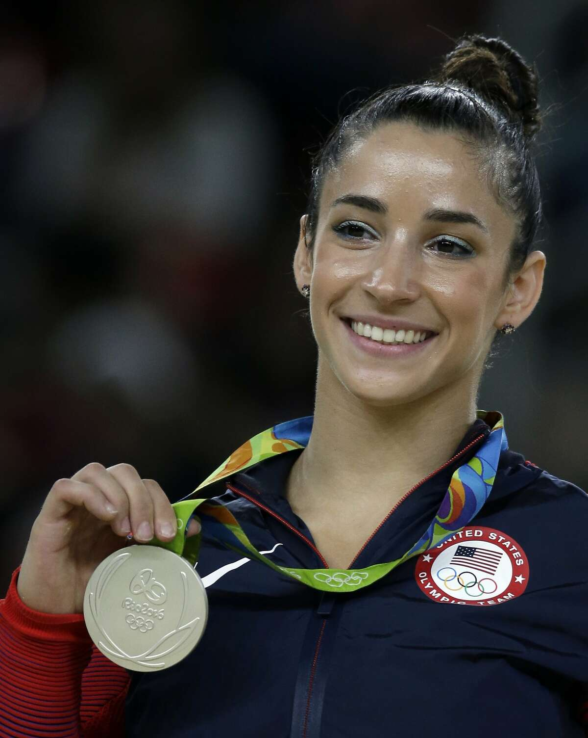 United States' Aly Raisman displays her silver medal for floor during the artistic gymnastics women's apparatus final at the 2016 Summer Olympics in Rio de Janeiro, Brazil, Tuesday, Aug. 16, 2016. (AP Photo/Rebecca Blackwell)
