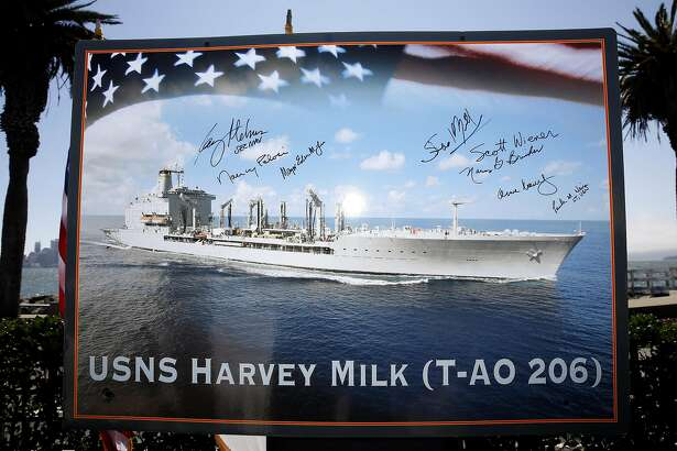 A picture of the new fleet oiler USNS Harvey Milk with signatures from several dignitaries on display after the naming ceremony for the ship at Treasure Island, California, on Tuesday, August 16, 2016.