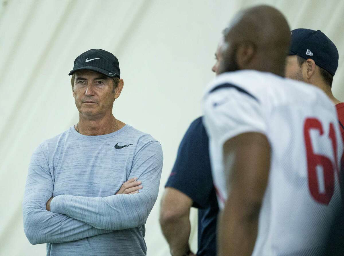 Former Baylor football coach Art Briles, left, was a conspicuous presence at the Texans' practice Tuesday as he makes the NFL rounds networking.