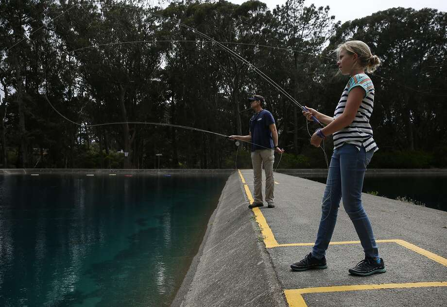 Maxine McCormick, 12, practices fly casting with her father, Glenn McCormick, at the Golden Gate Angling and Casting Club earlier this month in San Francisco. Photo: Leah Millis, The Chronicle