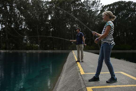 Maxine McCormick, 12, practices fly casting with her father Glenn McCormick for a photoshoot with the Chronicle at the Golden Gate Angling and Casting Club August 10, 2016 in San Francisco, Calif.