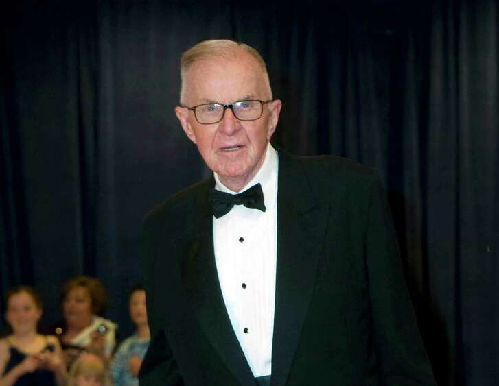 In this April 28, 2012, photo, John McLaughlin arrives at the White House Correspondents' Association Dinner on in Washington. McLaughlin, the conservative political commentator and host of the namesake long-running television show that pioneered hollering-heads discussions of Washington politics, died Tuesday, Aug. 16, 2016. He was 89. (AP Photo/Kevin Wolf)