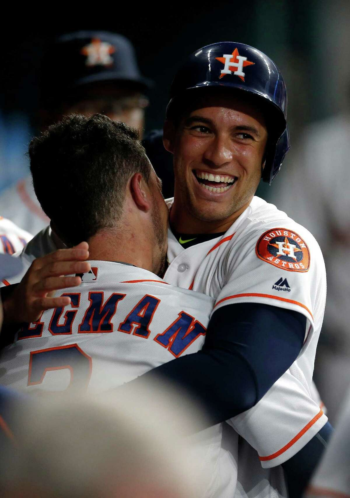Houston Astros third baseman Alex Bregman (2) celebrates with George Springer (4) after hitting his first major league home run during the first inning of an MLB game at Minute Maid Park,Tuesday, Aug. 16, 2016, in Houston.