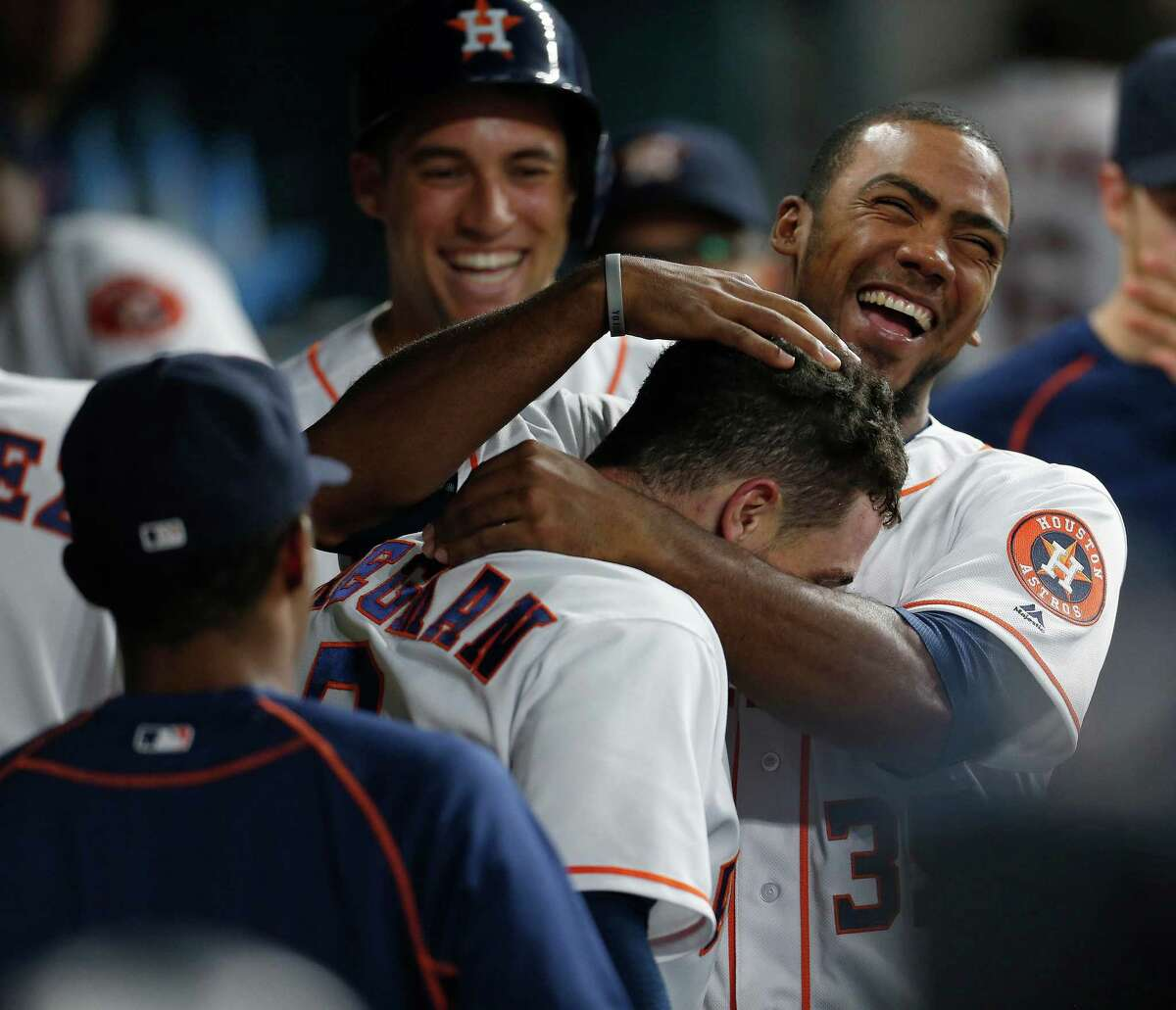 Houston Astros third baseman Alex Bregman (2) celebrates with Teoscar Hernandez (35) after hitting his first major league home run during the first inning of an MLB game at Minute Maid Park,Tuesday, Aug. 16, 2016, in Houston.