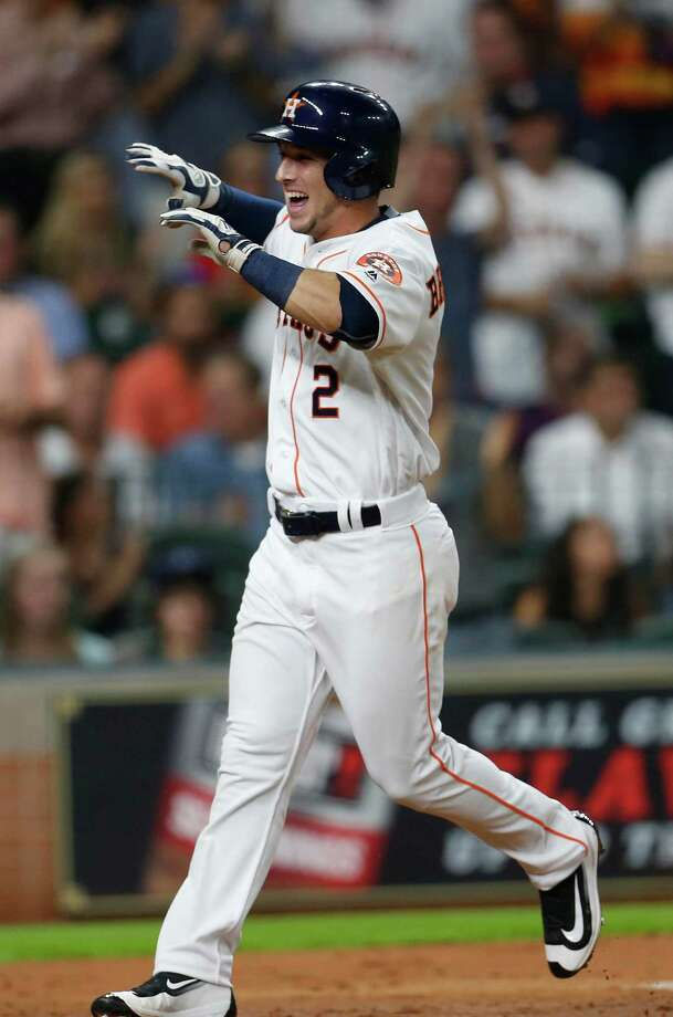 Astros third baseman Alex Bregman (2) reacts after hitting his first major league home run Tuesday against the Cardinals at Minute Maid Park. Photo: Karen Warren, Houston Chronicle / © 2016 Houston Chronicle