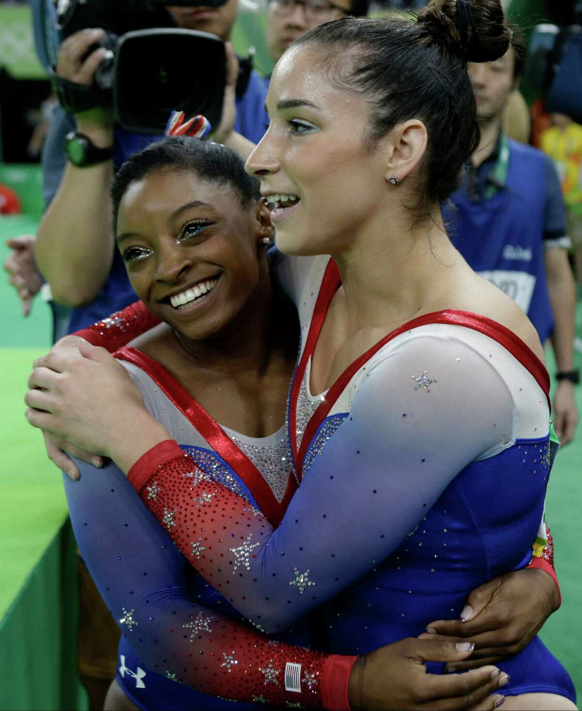Simone Biles, left, and U.S. teammate Aly Raisman rejoice in picking up the gold and silver medals in the floor exercise Tuesday.