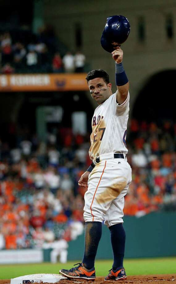Houston Astros Jose Altuve (27) acknowledges the crowd after getting his 1,000th hit, a single during the ninth inning of an MLB game at Minute Maid Park,Tuesday, Aug. 16, 2016, in Houston. Photo: Karen Warren, Houston Chronicle / © 2016 Houston Chronicle