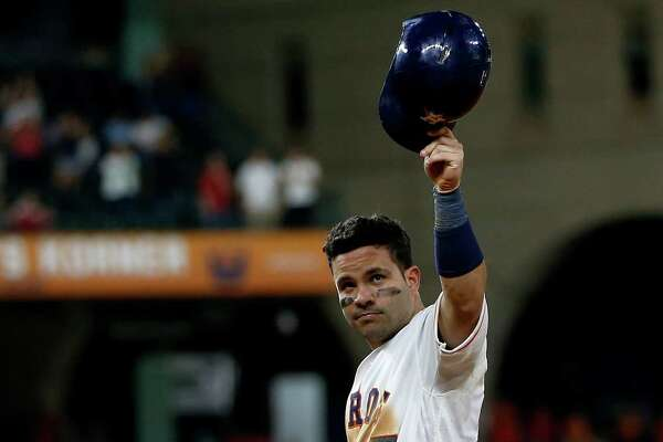 Houston Astros Jose Altuve (27) acknowledges the crowd after getting his 1,000th hit, a single during the ninth inning of an MLB game at Minute Maid Park,Tuesday, Aug. 16, 2016, in Houston.
