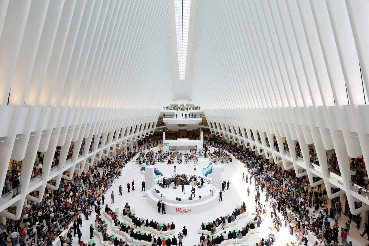 Crowds gather for a celebration for the opening of the Westfield World Trade Center mall in the oculus of the Transportation Hub, Tuesday, Aug. 16, 2016, in New York. (AP Photo/Mark Lennihan) ORG XMIT: NYML112