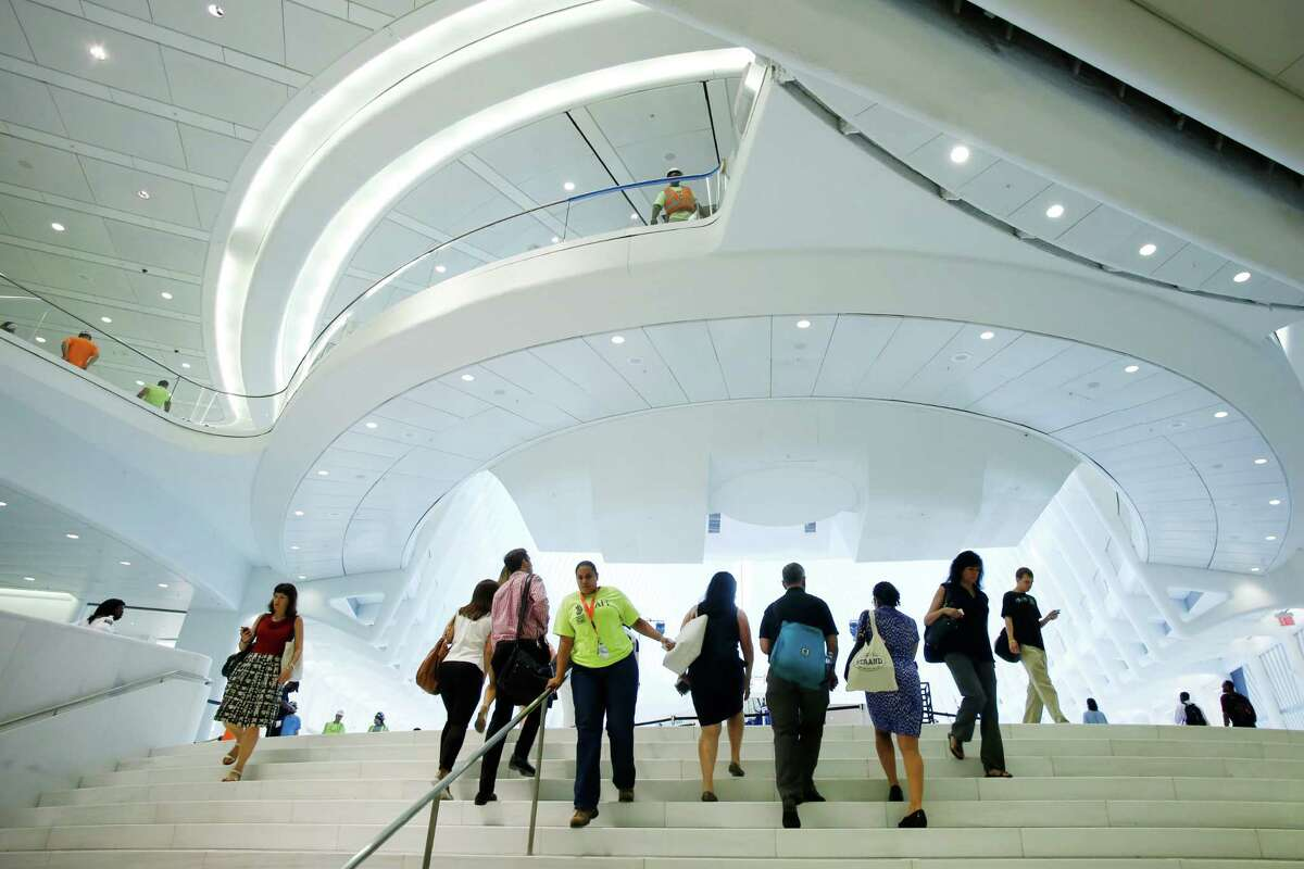 In this Monday, Aug. 15, 2016, photo, people walk the steps from the PATH commuter rail station into the World Trade Center Transportation Hub in New York. Westfield's retail mall opens Tuesday in the hub. (AP Photo/Mark Lennihan) ORG XMIT: NYML107