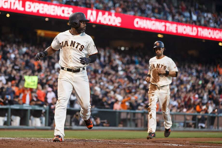With Angel Pagan on his tail, Denard Span scores on Buster Posey's first-inning double. Pagan scored as well. Photo: Jason O. Watson, Getty Images