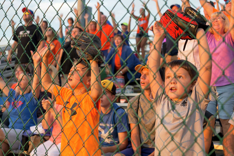 Midland fans wait to catch t-shirts being thrown over the fence at the Junior League World Series on Tuesday, August 16, 2016 at Heritage Park in Taylor, Michigan. Midland beat Maryland's Fruitland 12-2. Photo: Elaine Cromie, Elaine Cromie | For The Daily News