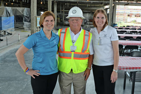 IBI Group Inc. assistant project manager Ann Frankovich, left, Cy-Fair ISD director of project management Jody Doebele and IBI project manager Laura Michela attend a safety milestone celebration at Bridgeland High School July 27.