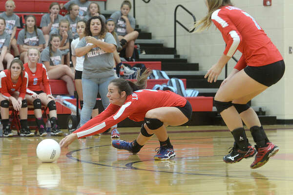Lumberton's Taylor Kyle dives to try and keep the ball alive against Bridge City during Tuesday's volleyball match-up at Bridge City High School. Photo taken Tuesday, August 16, 2016 Kim Brent/The Enterprise
