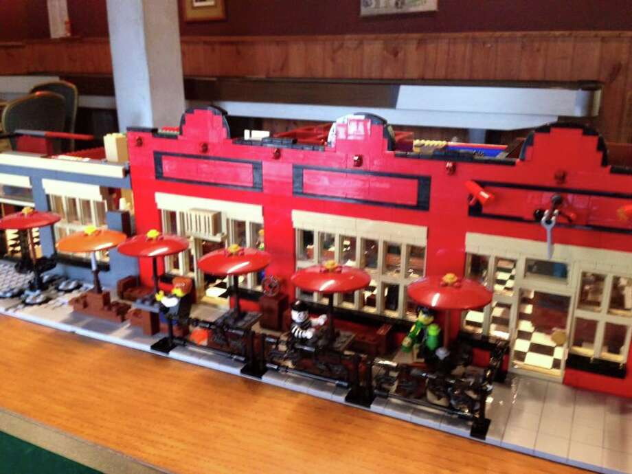 Rudyard's British Pub in Montrose, known best for amazing tater tots, cheeseburgers, and rock n' roll shows was remade this week in Lego form ahead of its 38th anniversary on Aug. 26-27, 2016.The Lego creation even has customers on the front patio smoking and drinking the night away and captures the checkered floor downstairs. Photo: Rudyard's Facebook