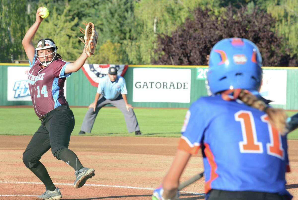 Greater Helotes pitcher Annika Litterio winds up while Grandville's Brooklyn Verbeek turns to bunt during the Texas team's 6-0 semifinal win Tuesday night.