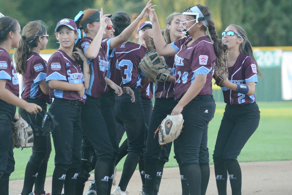 The Greater Helotes team celebrates after Annika Litterio strikes out the final batter to complete Tuesday's 6-0 semifinal win over Grandville, Mich.
