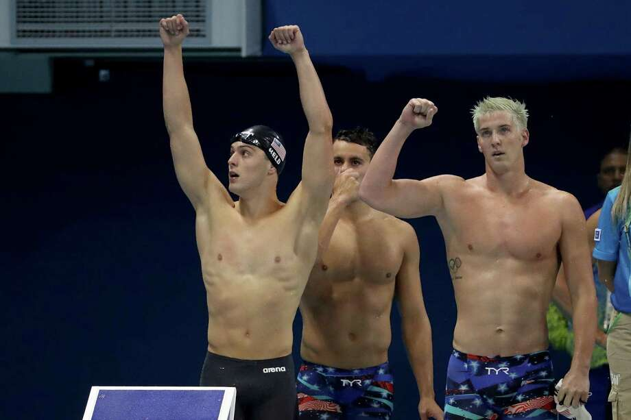 Jimmy Feigen (far right), Ryan Held and Blake Pieroni of the United States celebrate winning heat two of the men's 400-meter freestyle relay on Day 2 of the 2016 Rio Olympic Games at the Olympic Aquatics Stadium on Aug. 7. Photo: Al Bello /Getty Images / 2016 Getty Images