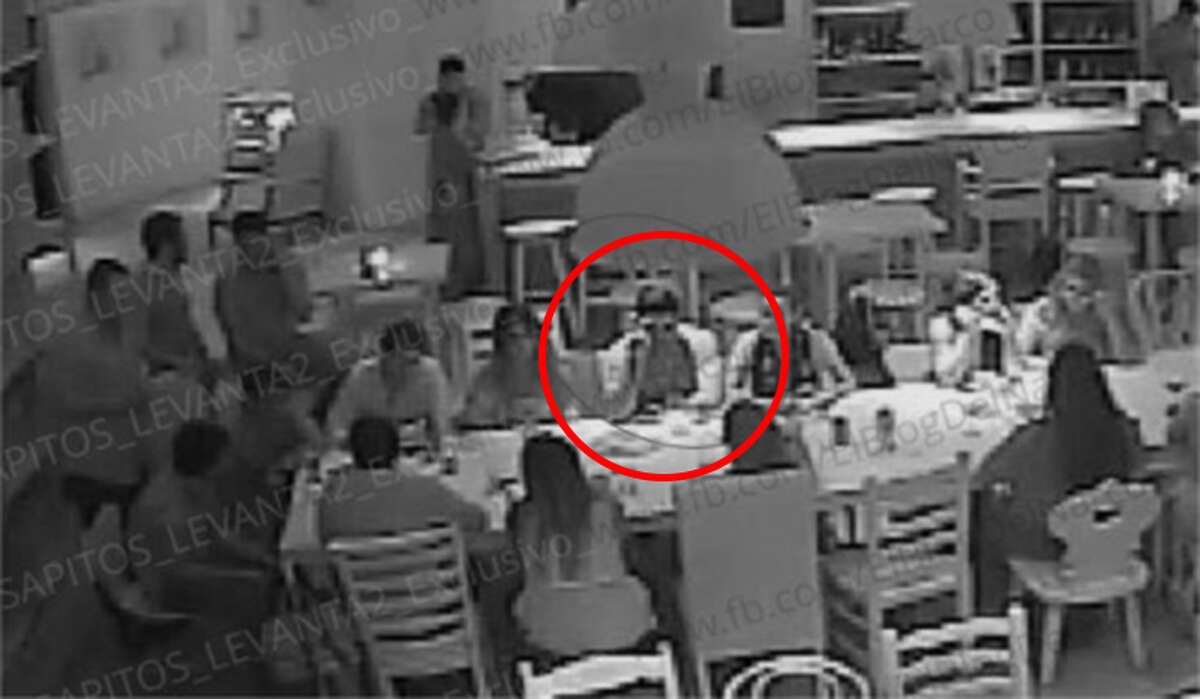 """Surveillance camera stills posted by Blog del Narco on Wednesday, August 17, 2016, purportedly show the armed abduction of Jesus Alfredo Guzman Salazar, the son of Sinaloa Cartel kingpin Joaquin """"El Chapo"""" Guzman, shown here in the red circle."""