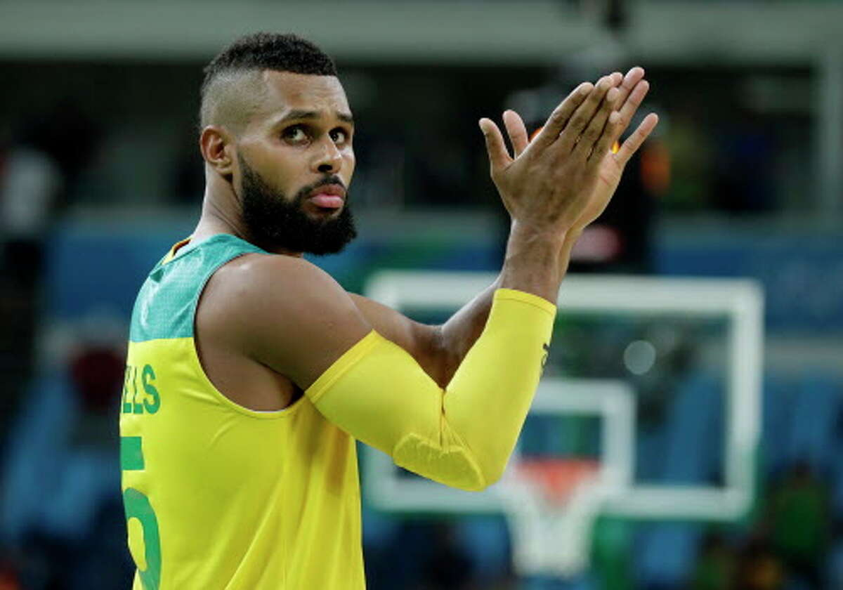 Australia's Patty Mills reacts to fans after a quarterfinal round basketball game against Lithuania at the 2016 Summer Olympics in Rio de Janeiro, Brazil, Wednesday, Aug. 17, 2016. (AP Photo/Charlie Neibergall)