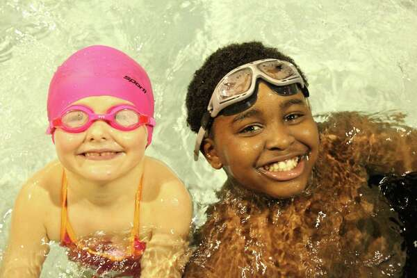 Youth swimmers at the New Canaan YMCA learning life-saving skills and having fun in the pool.