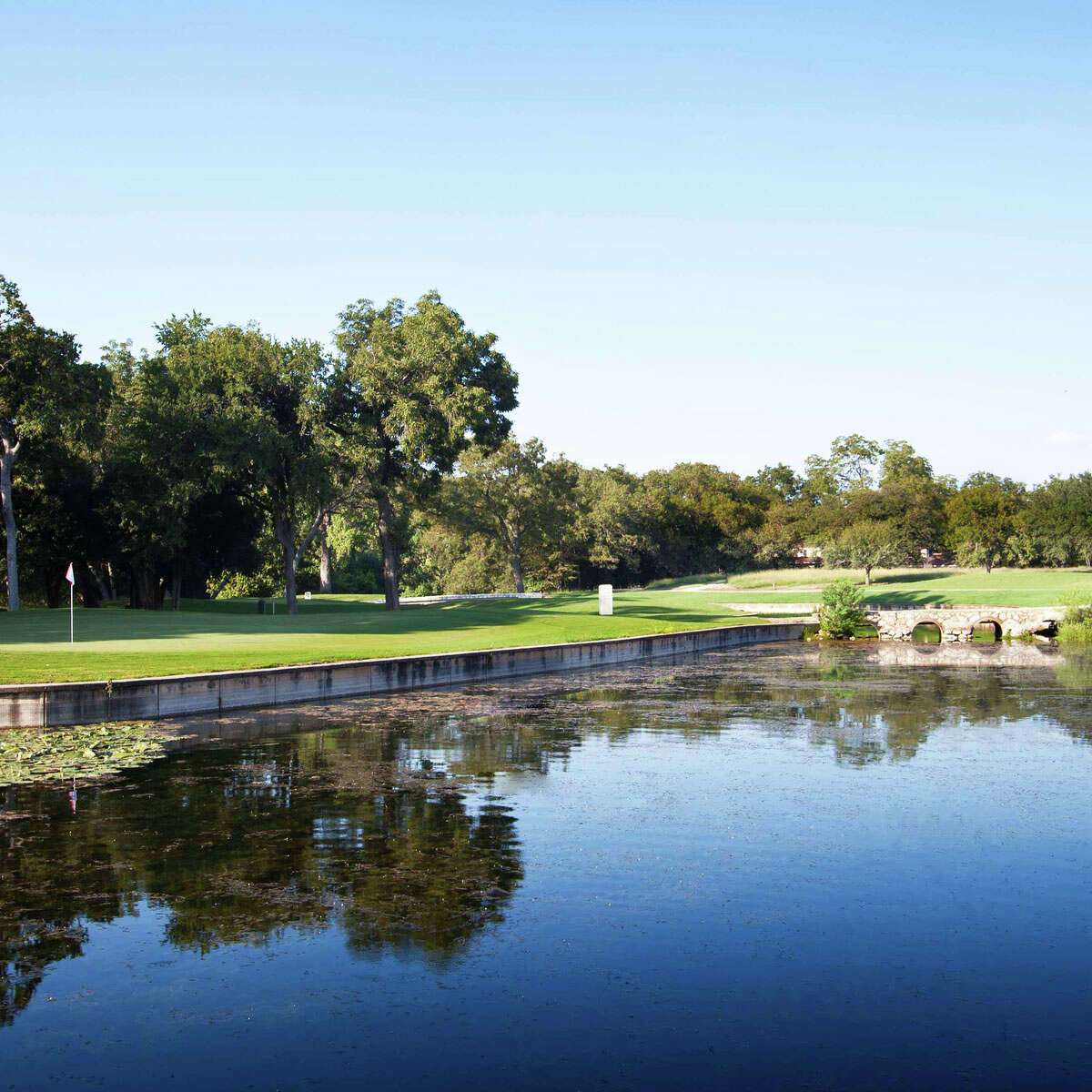 The Comal Springs come into play on several holes, like here, on #2 green. CLICK HERE to learn more about our renovated course.