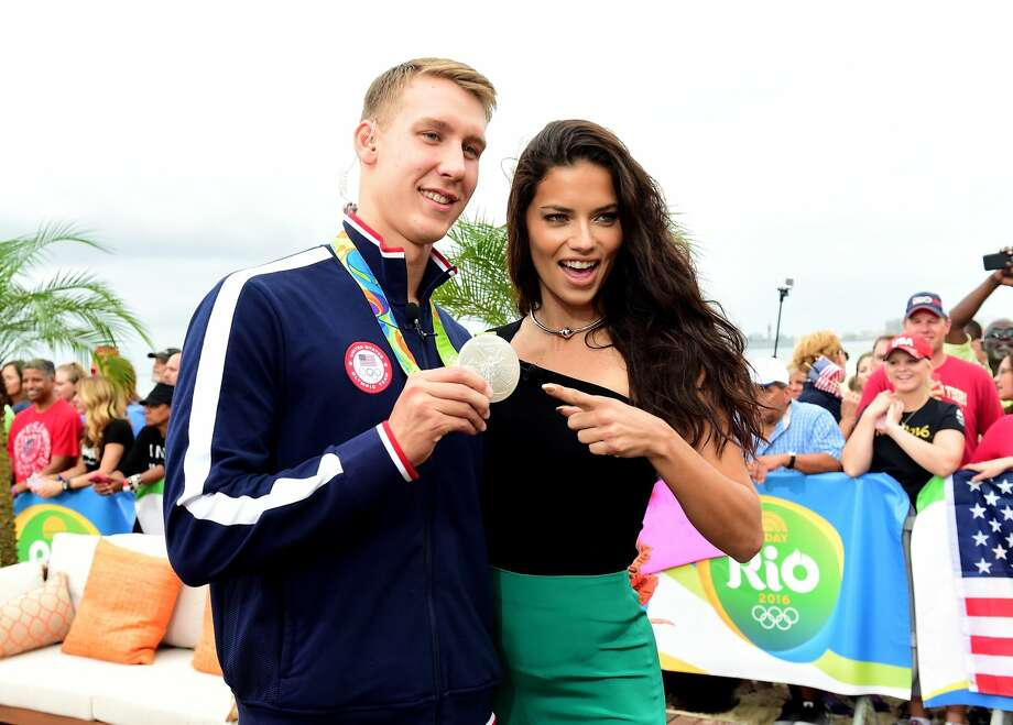 Model Adriana Lima and swimmer Chase Kalisz of the United States pose for a photo on the NBC Today show set on Copacabana Beach. Photo: Harry How/Getty Images