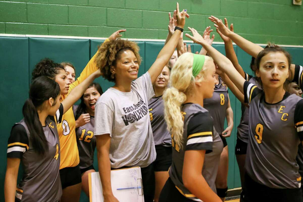 Jasmine Hales, new volleyball coach for the East Central Lady Hornets, celebrates with her team a victory in the 2016 Harlandale tournament.