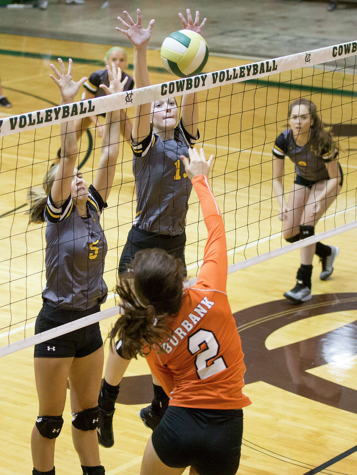 East Central's Madie Strzelczyk (left) and Sara Haycraft try to block a shot by Burbank's Pearl Alvear during their match at McCollum in the 2016 Harlandale ISD Volleyball tournament on Friday, Aug. 12, 2016. MARVIN PFEIFFER/ mpfeiffer@express-news.net
