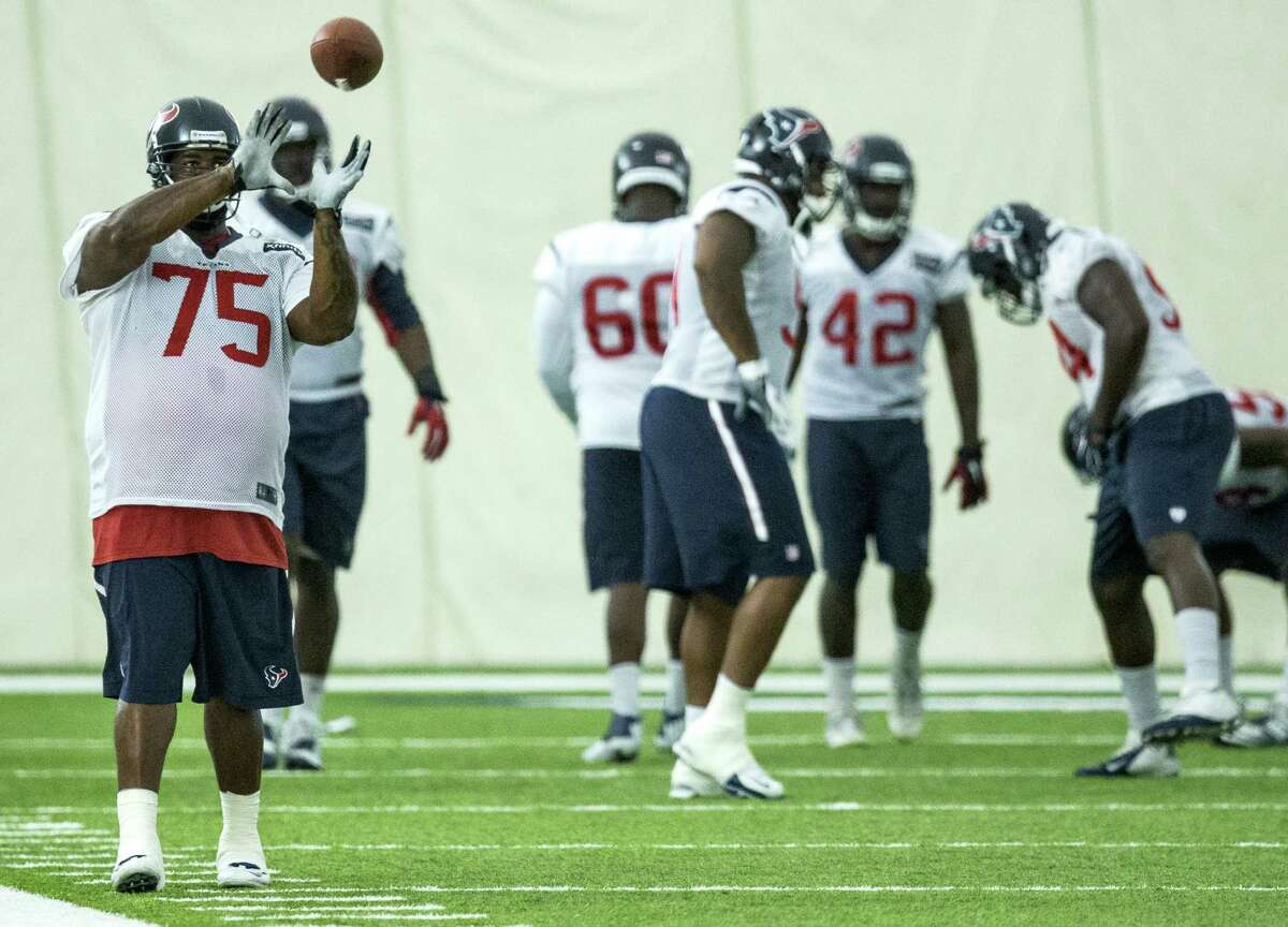 Houston Texans nose tackle Vince Wilfork (75) reaches out to catch a football during warm ups at Texans training camp at Houston Methodist Training Center on Wednesday, Aug. 17, 2016, in Houston.