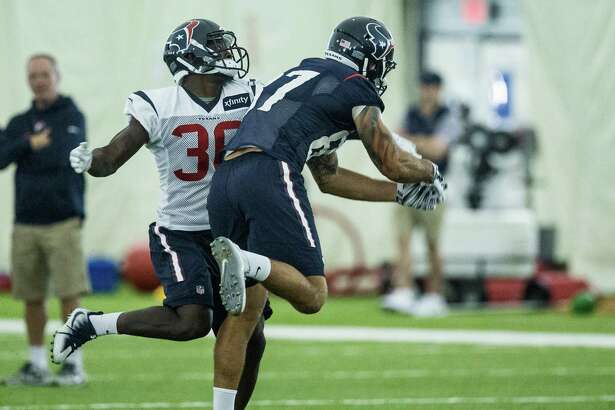 Houston Texans safety K.J. Dillon (36) knocks a pass away from tight end C.J. Fiedorowicz (87) during Texans training camp at Houston Methodist Training Center on Wednesday, Aug. 17, 2016, in Houston.