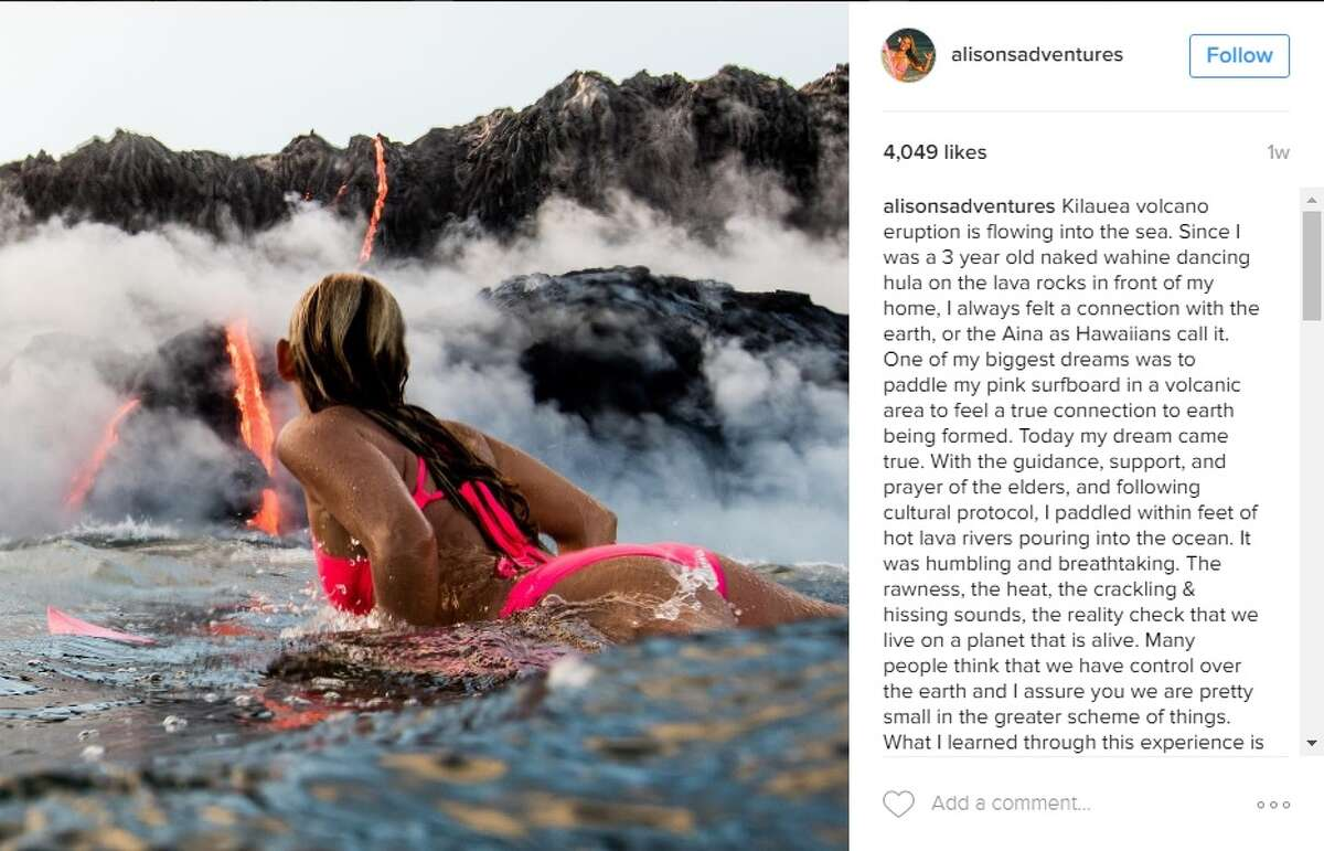 Alison Teal, filmmaker, swam in the water in Hawaii as a volcano erupted behind her on Aug. 10, 2016.