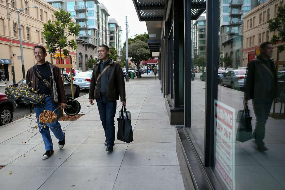 UCSF prostate cancer patient Joe Casserly (right) wears his Fitbit as he walks with his partner, Todd Young, to rehearsal for a show they're in at the Oasis in San Francisco. Photo: Amy Osborne, Special To The Chronicle