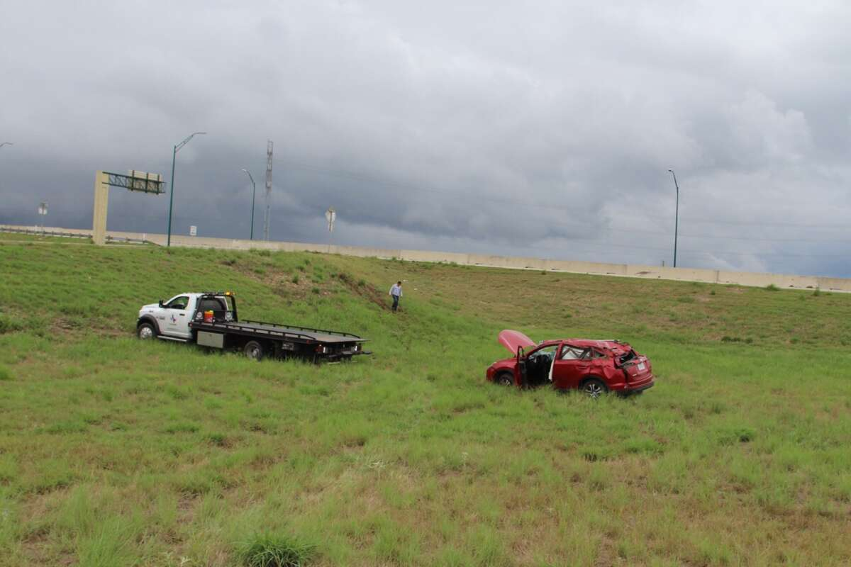 A woman rolled her car off the highway after an accident on Wurzbach Parkway near Wetmore Road Aug. 17, 2016.