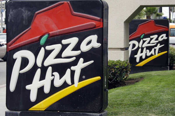 FILE - This Oct. 5, 2010 file photo shows the front of a Pizza Hut restaurant in Los Angeles. Pizza Hut says it will remove more artificial ingredients from its pizza pies in the next year. Pizza Hut says the preservatives BHA and BHT will be removed from all its meat by July 2016. Artificial preservatives in cheese will be cut by next year. Chicken used as pizza topping will be free of human antibiotics by March. (AP Photo/Reed Saxon)