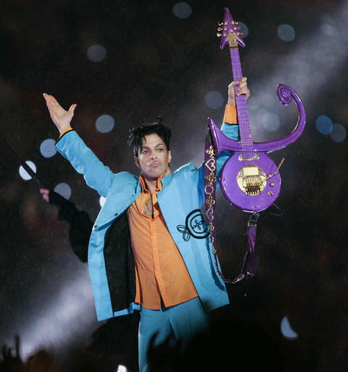 FILE - In this Feb. 4, 2007 file photo, Prince performs during halftime of the Super Bowl XLI football game in Miami. A posthumous honorary degree from the University of Minnesota is in the works for music legend Prince. The university's regents are set to vote Friday, June 10, 2016, on bestowing an honorary degree from the College of Liberal Arts to Prince Rogers Nelson, who made his home in Minnesota. (AP Photo/Chris O'Meara, File)