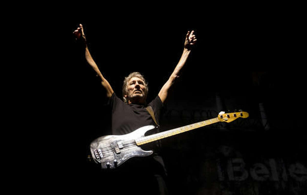 In this March 29, 2012 photo, bassist and singer Roger Waters, formerly of the English rock band Pink Floyd, performs in concert in Rio de Janeiro, Brazil.
