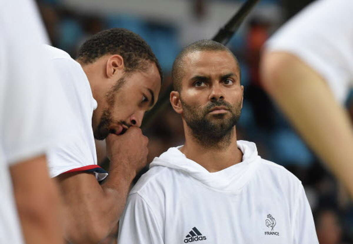 France's centre Rudy Gobert (L) speaks with France's point guard Tony Parker before a Men's quarterfinal basketball match between Spain and France at the Carioca Arena 1 in Rio de Janeiro on August 17, 2016 during the Rio 2016 Olympic Games. / AFP PHOTO / Mark RALSTONMARK RALSTON/AFP/Getty Images
